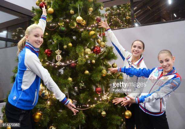 Photo taken on Dec 23 2017 shows Russian figure skater Alina Zagitova posing beside a Christmas tree after winning the women's title of the Russian...
