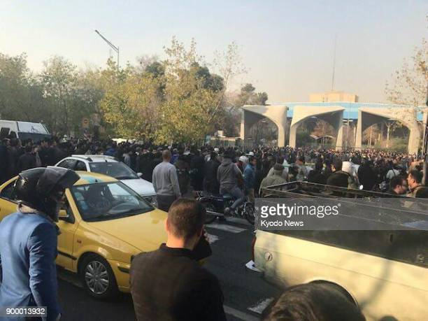 Photo taken on Dec 30 shows students gathering in front of Tehran University as they joined in antigovernment protests erupting across Iran ==Kyodo