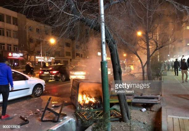 Photo taken on Dec 30 shows unrest on the streets of central Tehran Two people were killed overnight in the western province of Lorestan amid...