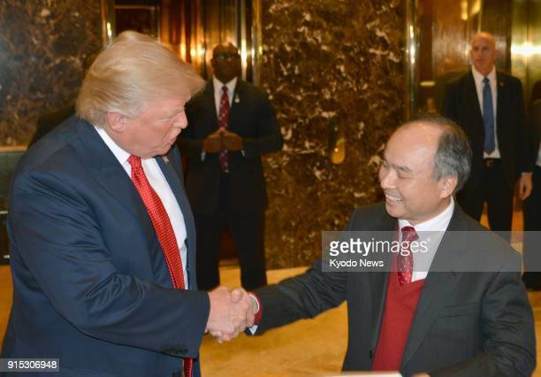 Photo taken on Dec 6 2016 shows US Presidentelect Donald Trump shaking hands with Softbank Group Corp CEO Masayoshi Son at Trump Tower in New York...