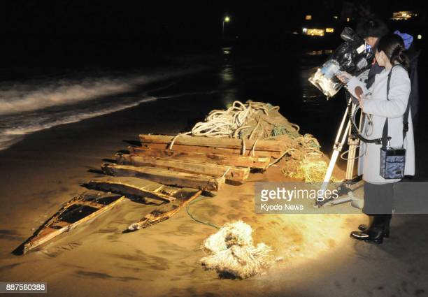 Photo taken on Dec 7 shows parts of a wooden boat that washed ashore in Sakai Fukui Prefecture Japan Coast Guard officials suspect the boat 45 meters...
