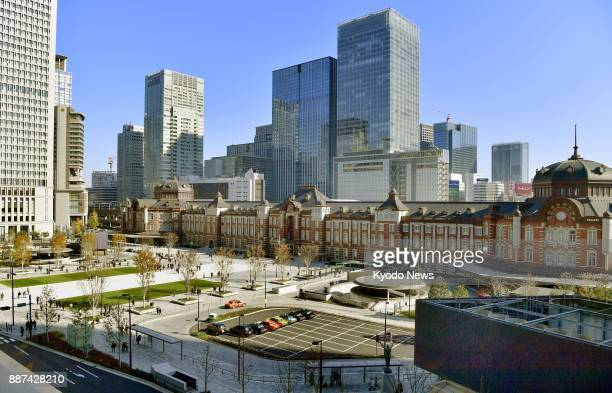 Photo taken on Dec 7 shows the redbrick Marunouchi Station Building and the JR Tokyo Station square in Tokyo after improvement works that started in...