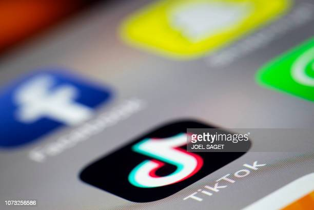 A photo taken on December 14 2018 in Paris shows the logo of the application TikTok TikTok is a Chinese shortform videosharing app which has proved...