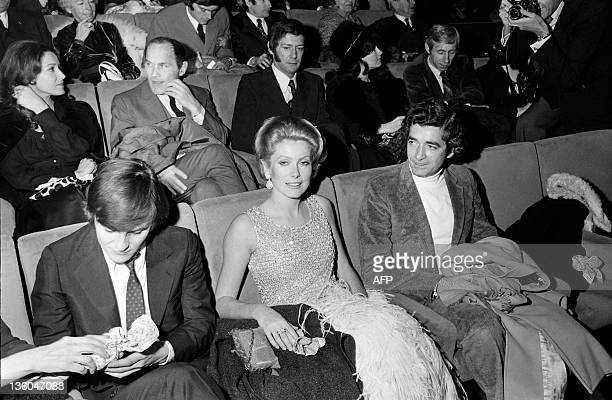 A photo taken on December 16 1970 shows French actress Catherine Deneuve flanked by film director Jacques Demy and actor Jacques Perrin at the...