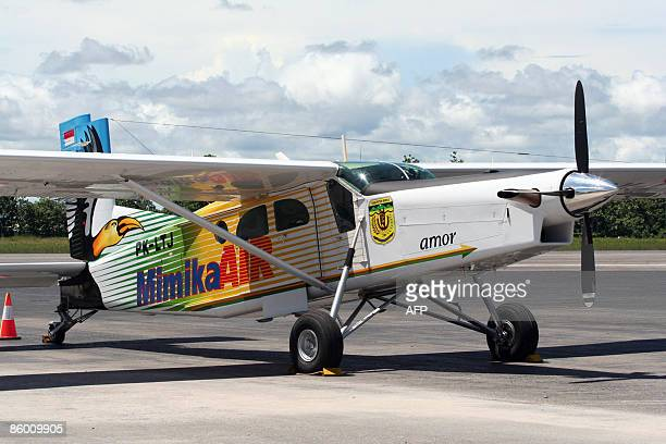 A photo taken on December 2 2008 shows a Pilatus turbo porter plane of the Mimika Air is parked at Timika airport Up to eleven people are feared dead...