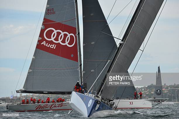 Photo taken on December 26 2015 shows Supermaxi yachts Ragamuffin 100 and Wild Oats XI before the start of the Sydney to Hobart yacht race in Sydney...