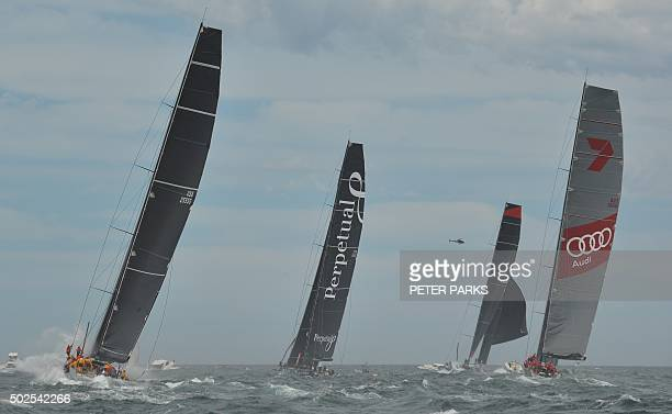 Photo taken on December 26 2015 shows Supermaxi yachts Rambler Perpetual Loyal Wild Oats XI and Comanche after the start of the Sydney to Hobart...