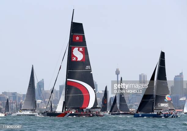 Photo taken on December 26 2019 shows Hong Kong Dovell 100 yacht SHK Scallywag sailing out of Sydney harbour at the start of the Sydney to Hobart...