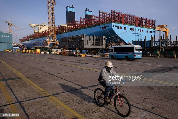 A photo taken on December 3 2014 shows a general view of an underconstruction Maersk tripleE class container ship at the Daewoo DSME shipyard in Okpo...