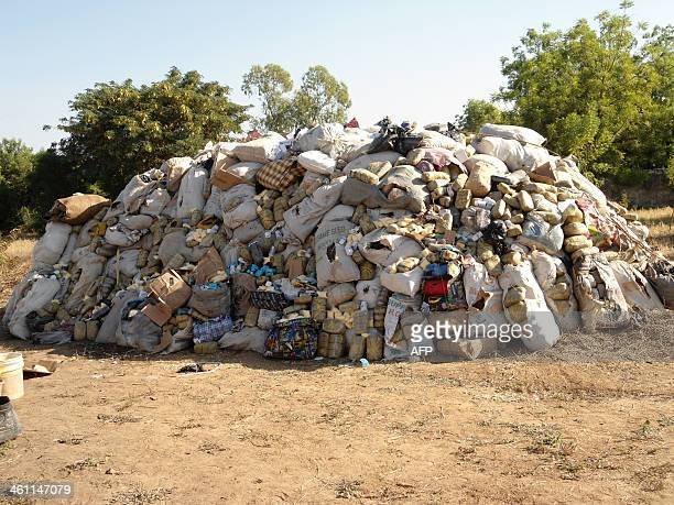 Photo taken on December 6 2013 shows over ten metric tonnes of impounded hard drugs on display for destruction at a ceremony in northern Nigeria's...