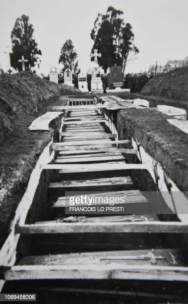 A photo taken on Decembre 5 2018 in Villeneuved'Ascq northern France shows a reproduction of a photograph showing coffins after the massacre of Ascq...