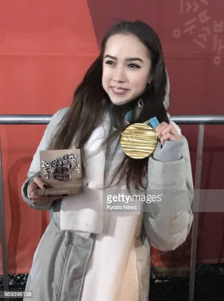 Photo taken on Feb 23 shows Russian figure skater Alina Zagitova holding her gold medal at the Pyeongchang Winter Olympics in South Korea Zagitova...