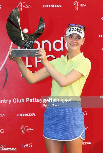 Photo taken on Feb 28 2018 shows Jessica Korda posing with her trophy after winning the Honda LPGA Thailand tournament at the Siam Country Club in...