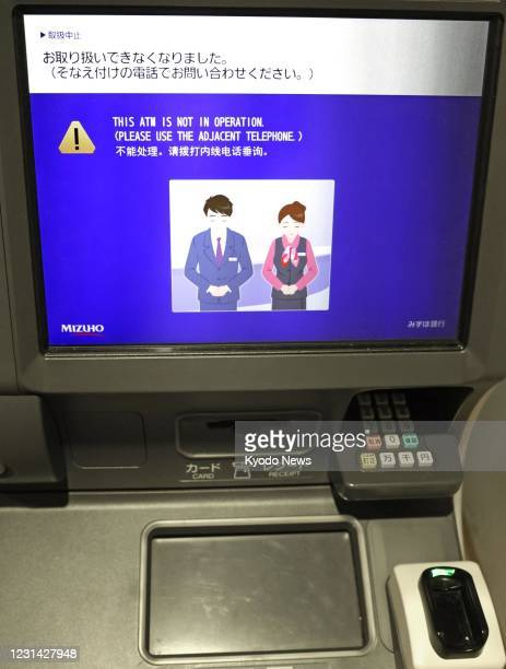 Photo taken on Feb. 28 shows a Mizuho Bank ATM in Tokyo hit by a glitch affecting cash withdrawals and other transactions at some of the major...