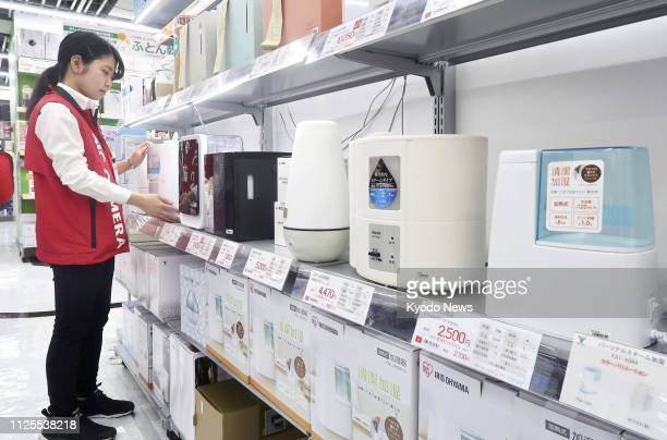 Photo taken on Feb. 5 at a BicCamera store in Tokyo's Yurakucho district shows a section for humidifiers, products drawing much demand during the...