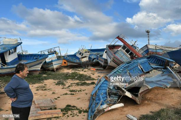 Photo taken on Feb 8 shows some of the many boats abandoned by refugees on the Italian island of Lampedusa a primary European entry point for...