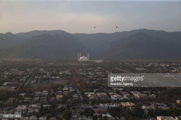 Photo taken on February 09 shows a view of Pakistani capital Islamabad with Faisal Mosque located on the foothills of Margalla Hills. Construction of...