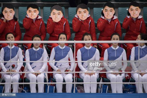 TOPSHOT A photo taken on February 10 2018 shows North Korean cheerleaders wearing masks as they perform during the women's preliminary round ice...