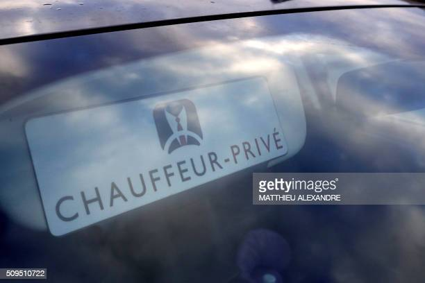 A photo taken on February 11 2016 shows a the logo of a private chauffeur of the ChauffeurPrive company displayed in the windshield of a vehicle as...