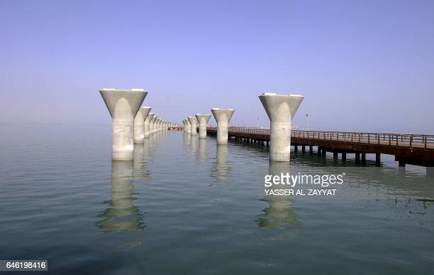 A photo taken on February 11 2017 in Kuwait City shows a general view of a construction site of the Sheikh Jaber AlAhmad AlSabah causeway one of the...