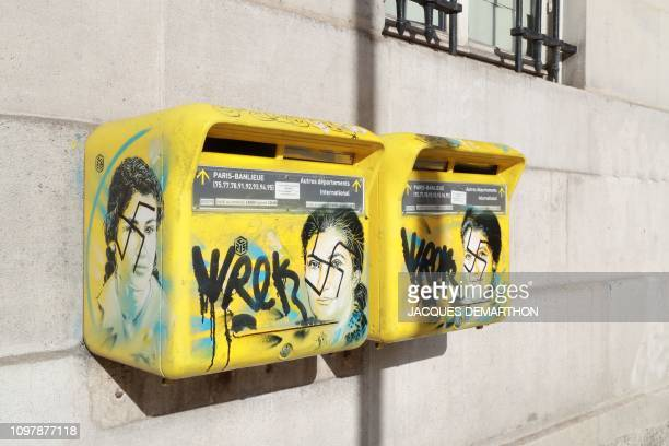 TOPSHOT A photo taken on February 11 2019 in the 13th arrondissement of Paris shows AntiSemitic graffiti written on letter boxes displaying a...