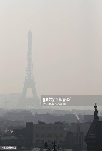 A photo taken on February 12 2015 in Paris shows the Eiffel Tower through thick smog AFP PHOTO / PATRICK KOVARIK