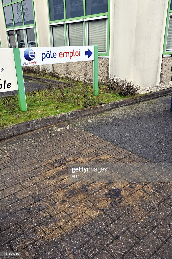 A photo taken on February 13, 2013 shows the place where a Frenchman set himself on fire outside a French state employment agency, Pole Emploi, in Nantes, western France. The man had sent messages to journalists warning he would set himself alight this week after being declared ineligible for unemployment benefits. The number of unemployed has risen steadily in France for the past 20 months, and could soon reach the record high set in January 1997 of 3.2 million.