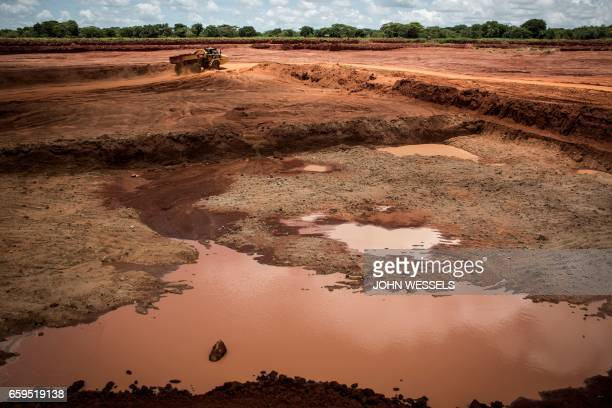 A photo taken on February 14 2017 shows an excavation area of the Gemfield's ruby mine in Montepuez Mozambique The stakes are high in Montepuez where...
