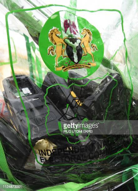 A photo taken on February 14 2019 shows card readers loaded in ballot boxes as they arrive at the headquarters of Independent National Electoral...