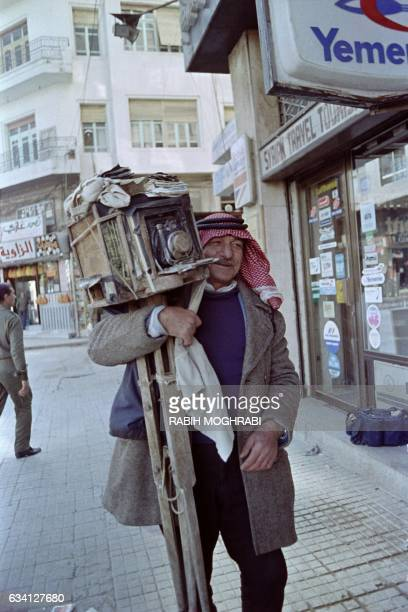 Photo taken on February 15 1989 in Damascus shows a street photographer working with an old tool camera used in the thirties in the souq El Hamidiye...