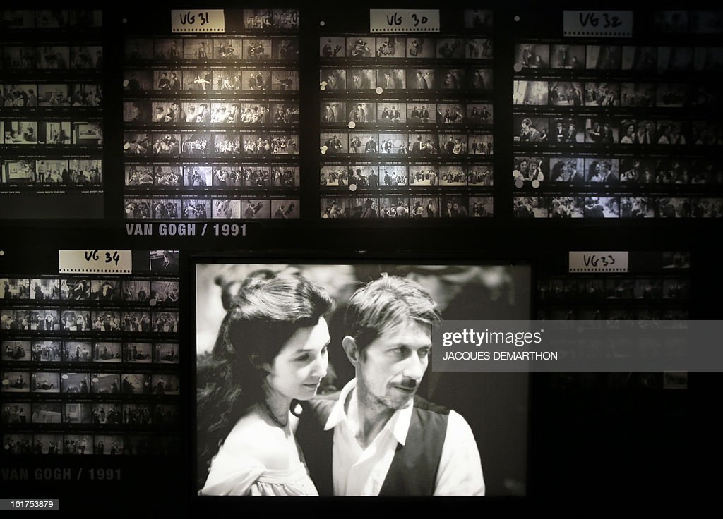 A photo taken on February 15, 2013 in Paris shows stills from the movie 'Van Gogh' (1991) on display at the French Cinematheque (La Cinematheque Francaise) during an exhibition dedicated to late French film director Maurice Pialat. The event will be held from February 20 to July 7, 2013. On the photograph, French actors Elsa Zylberstein and Jacques Dutronc.