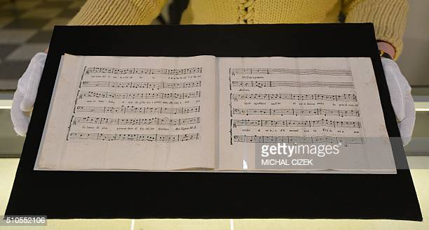 A photo taken on February 16 2016 at the Czech Music Museum in Prague shows the recently discovered sheets of music notes composed by Austrian...