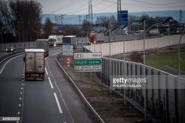 A photo taken on February 2 2017 in Calais shows a fourmetrehigh wall running along a kilometrelong stretch of the main road leading to Calais port...