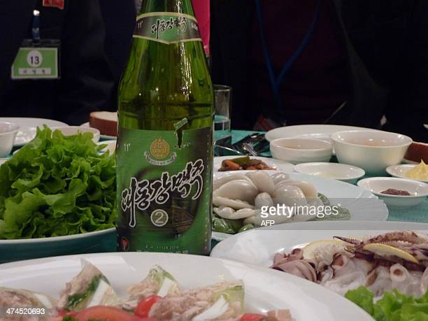 A photo taken on February 21 2014 shows a food and beer laid out on a table during family reunions between North ans South Koreans at the resort area...