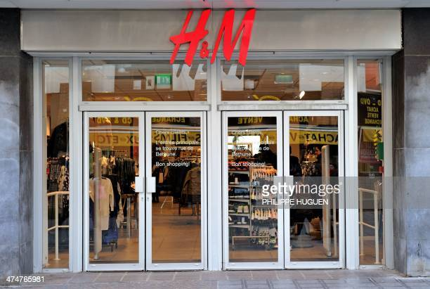 Photo taken on February 24 2014 shows the entrance of a HM clothing store in the French northern city of Lille AFP PHOTO / PHILIPPE HUGUEN