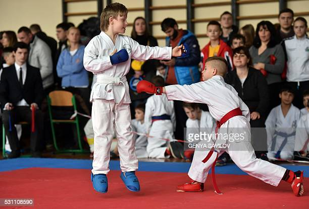 A photo taken on February 28 2016 in Kiev shows tenyearold Denys Nazarenko which has a Down syndrome taking part in a local karate championship In...