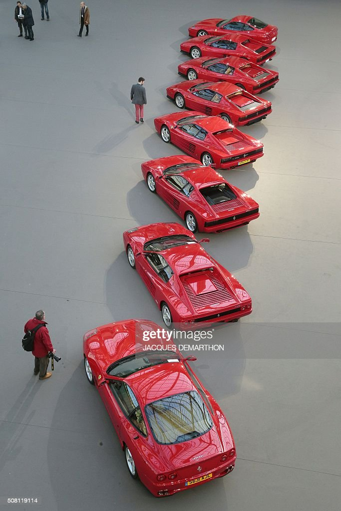 A photo taken on February 3, 2016 shows eight Ferrari cars on display for a sale of vintage cars and motorcycles at the Grand Palais in Paris. / AFP / JACQUES