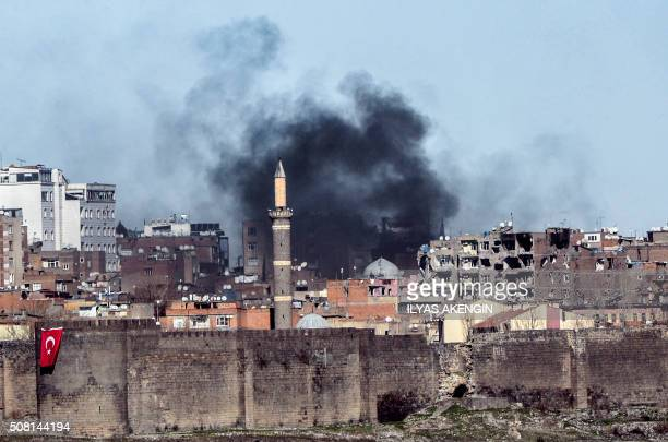 A photo taken on February 3 2016 shows smokes rising over the district of Sur in Diyarbakir after clashes between Kurdish rebels and Turkish forces...