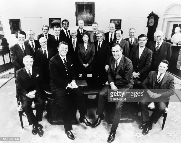Photo taken on February 4 1981 shows US President Ronald Reagan VicePresident George Bush and the Reagan Cabinet members Secretary of State Alexander...