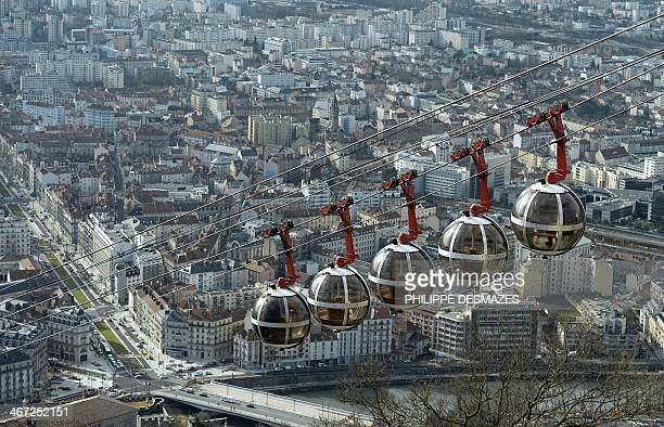 Photo taken on February 6, 2014 shows a view of the Grenoble-Bastille cable with the city of Grenoble in the background. The Grenoble-Bastille Cable...