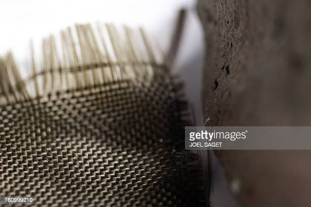 A photo taken on February 8 2013 shows basalt fibers from volcanic magma on display at the exhibition 'Futurotextiles 3' scheduled until July 14 at...