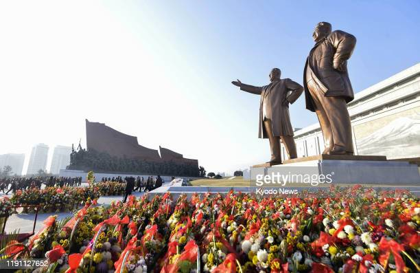 Photo taken on Jan. 1 shows Mansu Hill in Pyongyang, where statues of former North Korean leaders -- the country's founder Kim Il Sung and his son...