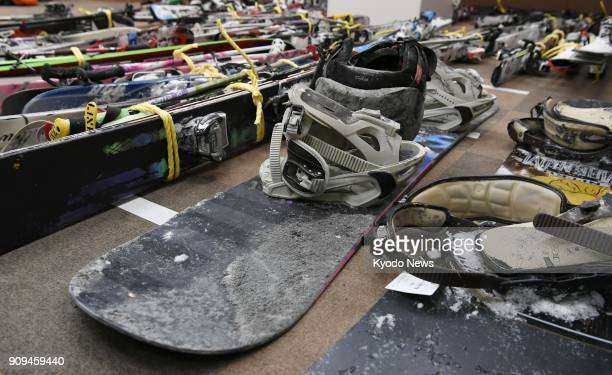 Photo taken on Jan 23 2018 shows snowboards and skis covered with volcanic ash in Kusatsu Gunma prefecture northeast of Tokyo They were being used by...