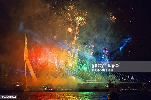 A photo taken on January 1 2016 shows fireworks over the Erasmusbrug during New Year's Eve in Amsterdam / AFP / ANP / robin utrecht / Netherlands OUT