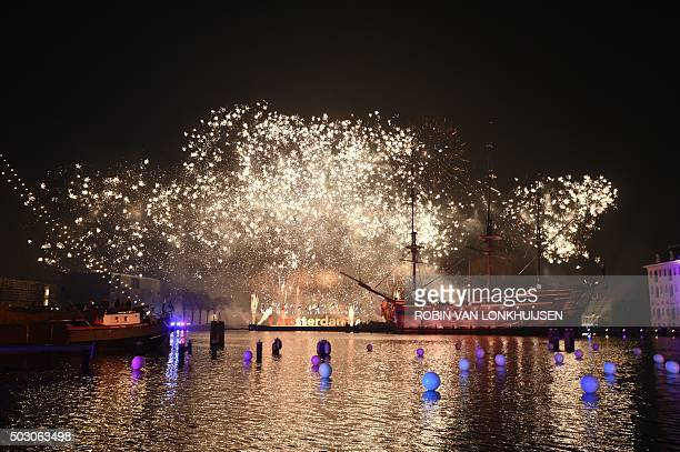 A photo taken on January 1 2016 shows fireworks ver the Scheepsvaartmuseum during New Year's Eve in Amsterdam / AFP / ANP / ROBIN VAN LONKHUIJSEN /...