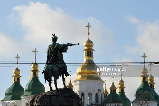 A photo taken on January 11 2012 shows the monument to Cossack leader Hetman Bohdan Khmelnytsky in front of the gold domes of the SaintSophia...