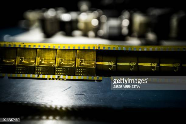 A photo taken on January 12 2018 shows a rare nitrate film reel of the movie 'Detained' a silent comedy with British actor Stan Laurel from 1924...