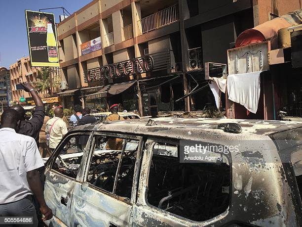 Photo taken on January 18, 2016 shows the bombed car wrecks and damage outside the Cappuccino cafe in Ouagadougou, following the terror attacks in...