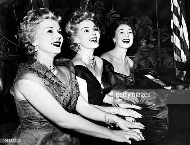 A photo taken on January 1954 shows US actress Zsa Zsa Gabor and her sisters Eva and Magda playing piano for new year day AFP PHOTO