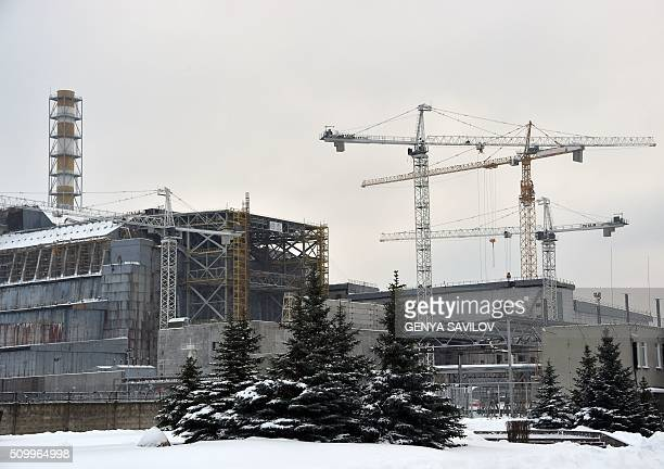 A photo taken on January 22 2016 shows a construction site next to a shelter and containment area built over the destroyed fourth block of the...